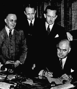Amsterdam native John T. Degraff (standing in middle) watches NY Gov. Herbert Lehman sign 1937 Civil Service bill